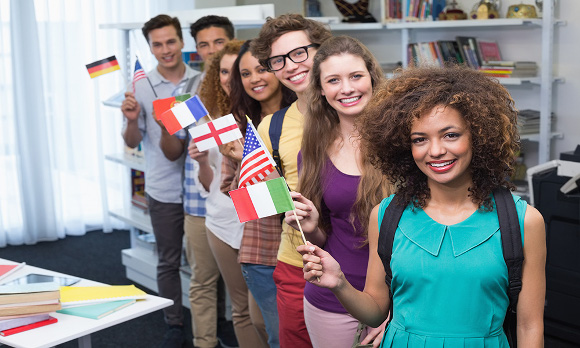 Happy students waving international flags at the college